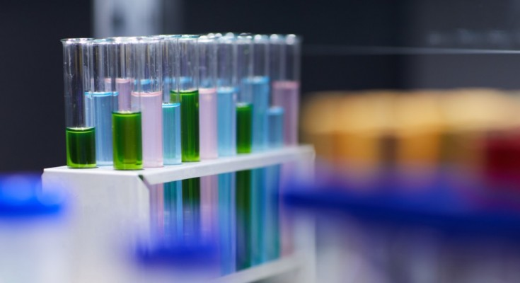 Background image close up of test tubes with colored liquid on table in laboratory, copy space